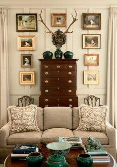 Traditional. Love the walls, the color, the dog paintings, the antlers, the chest, everything