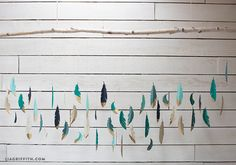 Make your own stunning paper feather garland or backdrop with this simple downloadable pattern and project by handcrafted lifestyle expert Lia Griffith.