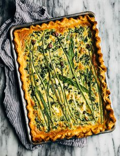 Ideal for Mother's Day brunch or spring gatherings, this sheet pan spinach quiche, made with ramps, green garlic, and chives, is a delicious way to feed a crowd.
