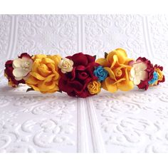 Find this piece here: https://www.etsy.com/listing/215820111/the-burgundy-yellow-and-turquoise-roses