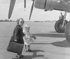 These two young sisters aged four and 17 months, were pictured boarding a Zurich-bound plane at Croydon aerodrome in 1938. They were travelling on their own, to be met by their aunt upon arrival.