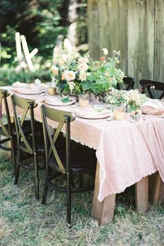wedding reception tablescape with greenery and blush