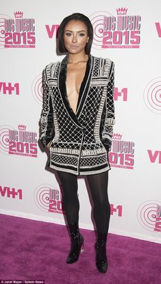 Revealing: Kat Graham, 26, showed plenty of cleavage in an extreme plunging luxurious blaz...