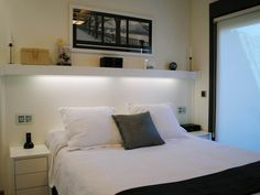 Love this cute shelving setup behind master bed, the lighting on the underside is a great addition!