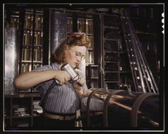 (Courtesy  |  Library of Congress) A woman assembles a section of the leading edge for the horizontal stabilizer of a plane at North American Aviation, Inc., Inglewood, Calif. Oct. 1942.