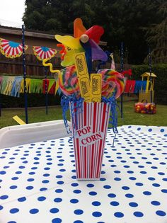 My centerpieces: popcorn tubs, pin wheels, suckers, and raffle tickets.