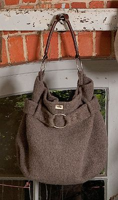 I want to make this Purse so bad. But I cant break down and buy the purse handles, because the cost $60, plus the yarn will be about $60 as well, then some frabric to line it and my precious time. Soon I will make it, I have to.