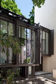 """Maison Escalier by Moussafir Architectes Associés. I love that these super cool """"shutters"""" open and close but let light and air in."""