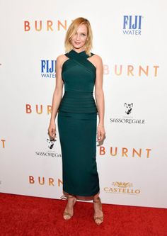 """At the premiere of """"Burnt,"""" Uma Thuman stepped out wearing Alexandre Birman sandals and a green dress by Brandon Maxwell."""