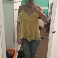 HPYellow frilly top from forever 21 NWOT NWOT yellow frilly forever 21 top straps tie in back to adjust strap length never worn Forever 21 Tops