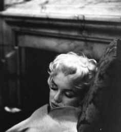 Asleep in her chair, Marilyn Monroe at rest.