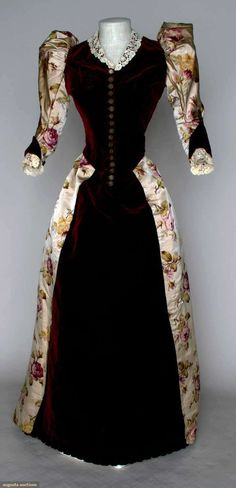 """Velvet and silk reception gown. 1894. 2 piece cranberry velvet & watered rose print on ivory satin, bodice w/ CF & CB waistpoints, brussels lace collar & cuffs, petersham label, """"A. Felix, Brevete, Paris"""", 17 stamped brass buttons, trained skirt, B 28"""", W 22"""", skirt L 38""""-54"""