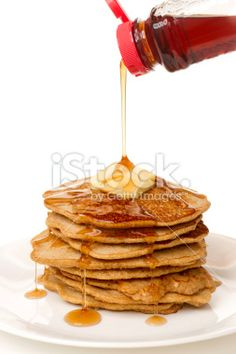 Large Stack of Eight Pancakes,Syrup being Poured from Bottle Royalty Free Stock Photo