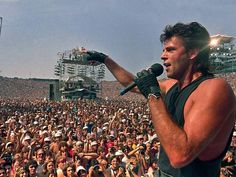Live Aid was held July simultaneously at JFK Stadium in Philadelphia and at Wembley Stadium in London. The concert was organized by Bob Geldof and . Midge Ure, High School Crush, Bob Geldof, Live Aid, Rick Springfield, Hot Blue, Back In My Day, Wembley Stadium, Band Aid