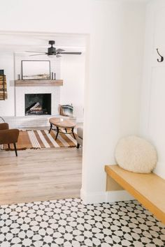 How to Paint a Fireplace - Dated Fireplace Transformation - Our Flip House - Modern Living Room - White Paint Wood Mantle - Modern Boho Living Room - Metal Firewood Wall Holder - Fireplace DIY - DIY Paint Fireplace - Farmhouse Living - Jolie Paint - Easy DIY Project - Black Fan in Living Room -  Flip House
