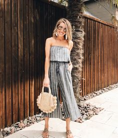 striped jumpsuit and straw bag outfit for spring and summer
