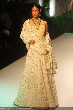 Nethra Raghuraman displays a creation by designer Meera Muzaffar Ali on Day 2 of India Bridal Fashion Week in New Delhi on July 24, 2013