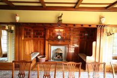 Seated inglenook fireplace, The Gables, designed by Arthur Nunweek 1912. A large dining room accessed from the galleried hall with inglenook fireplace and wood parquet flooring.