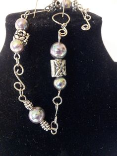 "8"" bracelet-tibetan silver/irridescent glass pearls. Starting at $4 on Tophatter.com!"