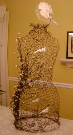 I tried this vine/birds design with one of my leftover chicken wire dress forms, and it was fun to work with......the vine at the top holds ...