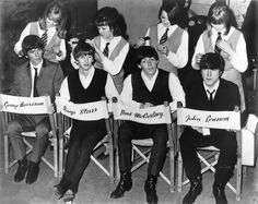 The Beatles are attended to by hairdressers during a break in the filming of A Hard Day's Night, 1964.