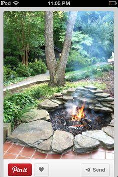 Rock fire pit so pretty!!
