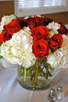Our Parties: 70th and 60th This Is Your Life Birthday Party Centerpiece - white hydrandeas and red roses