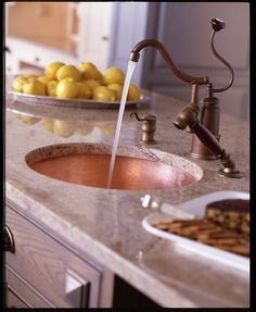 Herbeau DeDion faucet & handpsray in Weathered Copper & Brass + Moselle bowl in Polished Copper.