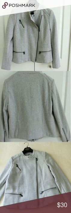 """GAP Moto Jacket L Just so well made and comfy! Heather grey. Measuring approx 20"""" across bust, 24.5"""" front length and 22"""" back length. Shoulder width across the back is approx 16"""" with the sleeves being 25"""". Two zippered front pockets, faux little zip pocket. Sleeves also have zippers. Two snap closure along with the zipper. Materials are 80/20 Cotton /Poly Shell, and Lining is Polyester / 5% Spandex. This is a thick, warm jacket. Please see the small different color in the back, pic 8. GAP…"""