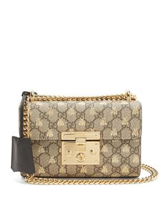 Click here to buy Gucci Padlock GG Supreme small cross-body bag at MATCHESFASHION.COM