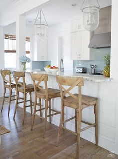 beach house kitchen design coastal kitchen decor how to design a beach house kitchen x back wooden bar stools stainless metal vent hood aqua glass subway Beach House Furniture, Beach House Decor, Home Decor, Beach Houses, Beach Kitchen Decor, Nautical Kitchen, Coastal Furniture, Beach Condo, Beach House Kitchens