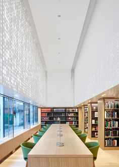 Coffey Architects has added a library with a perforated facade to London's Science Museum