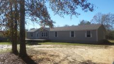 This doublewide home has a lot of possibilities with 4 bedrooms and 2 baths sitting on 1 acre. Featuring a large dining room with an open floor plan into the living room with a fireplace. Carpet was taken up, so you have a blank canvas to work with and personalize it with your taste. Large home with great possibilities. Needs T.L.C.