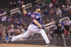 May 13, 2014; Minneapolis, MN, USA; Minnesota Twins relief pitcher Glen Perkins (15) pitches in the ninth inning against the Boston Red Sox at Target Field. The Minnesota Twins win 8-6. Mandatory Credit: Brad Rempel-USA TODAY Sports