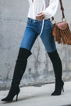 Black knee high suede stiletto boots.