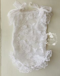 Zoe lace romperSize | Newborn Color | WhiteDetails | Delicate lace Romper with silk TiesCare | Spot cleanNote | Product intended as a photo prop. Do not leave baby unattended.Photo | Ama Bella Rosa