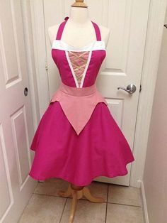 This is an adult size Sleeping Beauty costume apron. Made of cotton.The skirt is a wrap style that provides full coverage in back yet is adjustable to Disney Aprons, Disney Dresses, Apron Dress, Dress Up, Princess Aprons, Princess Apron Pattern, Disney Princess, Sleeping Beauty Costume, Cute Aprons