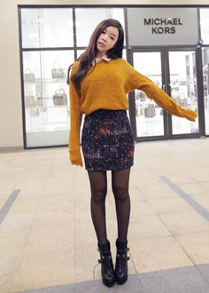 High waisted pencil skirts are a staple, especially long. Accentuates waist and looks classy yet feminine. Pair with a long-sleeved turtleneck, baggy sweater, nice blouse, etc.