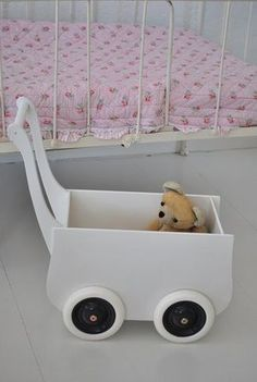 Doll's pram, both kids would love this, just to fill with toys and push around