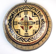 I wanted to make a clock face using the bottom of a gourd. I wound up with this and liked  it just the way it was. I thought if I added clockworks that it would just be too busy. I am always  inspired by African designs and this fits in well with SW or Tribal type decor.    Gourd has a round black leather cord attached for hanging flat on any wall or open space. Gourd is 8 inches in diameter and approx. 2 inches in depth.