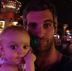 Alan Powell with his little girl Presley! He stole the poor baby's binky that's adorable