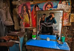 https://flic.kr/p/bDSyvJ   Selfshot Street Photography @ Subhash Salon   So I was walking on the streets of old town Dhaka, found this small barber salon with only one seat between the narrow spaces of two buildings and stopped for a picture. While I was changing my camera setting for a perfect exposure, curious people gathered around me. Remind you that we don't have any shortage of curious people in Bangladesh. they are everywhere in your frame :P   Lens:  Canon EF 16-35mm 2.8L II USM…