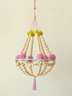 ❊ This crown chandelier is made with unpolished wood beads, supported by tiffany blue cotton yarn ring. Decorated with pretty lilac/silver flower-like yarn pompons in the middle, and with warm yellow pompons at the top❊ Materials: Wooden beads Metal ring Lilac cotton yarn Tiffany