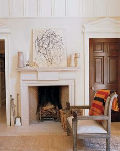 Michael S. Smith's Home, concrete mantel with exactly the right size fire box.