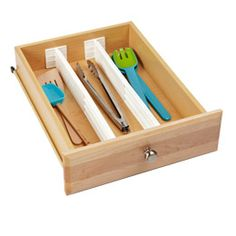 """Kitchen Dream Drawer Organizer  Bring order to your drawers with our innovative, expanding Kitchen Dream Drawer Organizers. They are spring-loaded to fit just about any drawer that's at least 3"""" deep. They are easily adjustable to create flexible, customized organization as your needs change."""