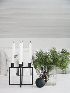 A Scandinavian Christmas. Decorate your table sparsely with a black candleholder, Christmas ball and fresh pine tree clippings in a vase. (Source: Salad Days)