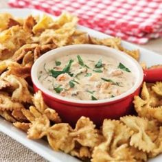 This creamy, spicy crawfish dip with fried bow tie pasta will be your favorite new party appetizer.