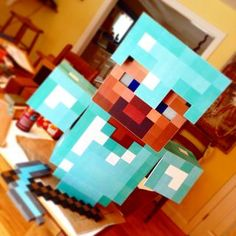 My son is a huge fan of Minecraft and wanted to be Steve for Halloween.This Minecraft costume was made from paper, cardboard, packing tape, wood and metal flashing. ...