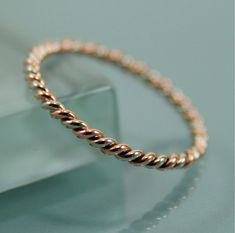 I actually own this ring!! I looked at it for ages and ages before finally buying two of them to stack with my engagement ring and wedding band. So happy I did. I love the rings!! They are delicate and beautiful. And my first Etsy purchase, too!! (Two Tone 14k SOLID Gold Very Skinny Twisted Rope Infinity Band Stacking Ring Mixed Metals Rose Gold and White Gold Shiny Finish)