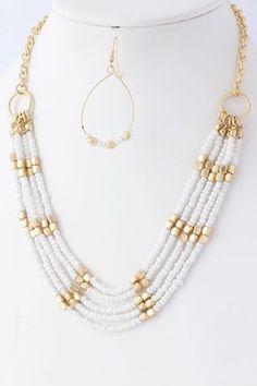 e2cf8dceb698 Collar blanco y dorado